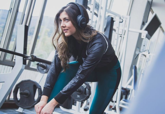 Woman working out listening to music